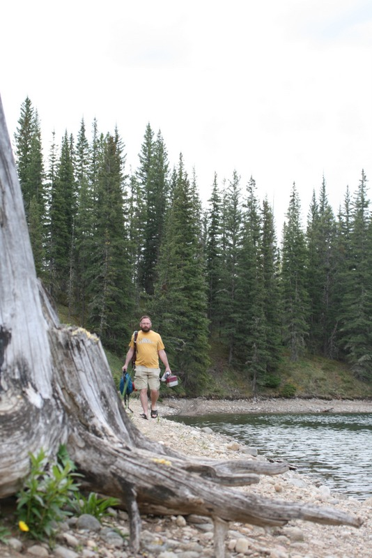 My husband with his fishing gear, on a mission to catch dinner, Trout Pond