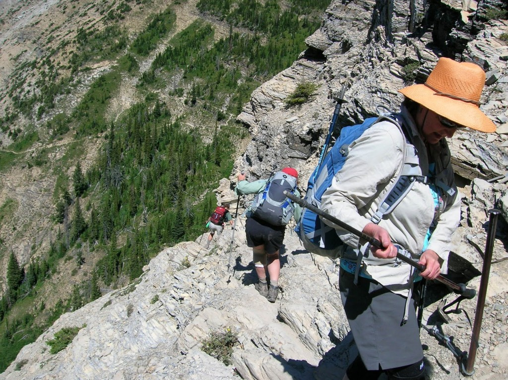 Climbing down the cable assisted stretch of Crypt Lake Trail