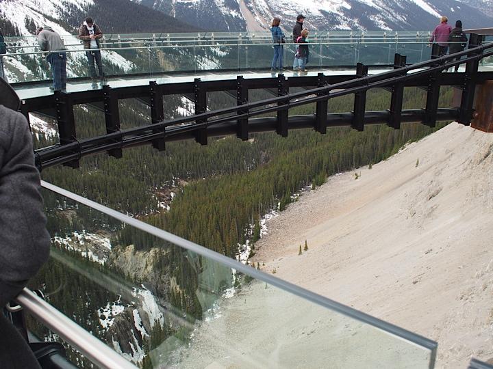 Visitors checking out the glass platform at Glacier Skywalk